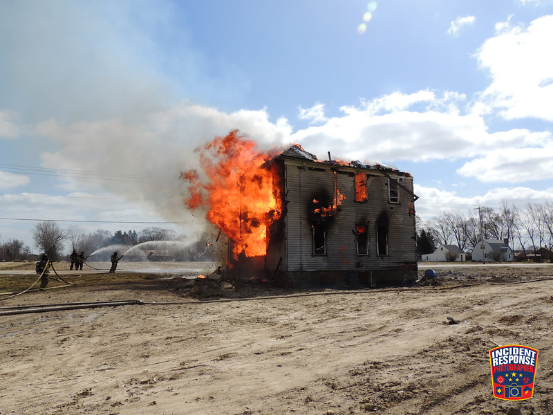 A balloon framed house went up in flames as firefighters from the Caledonia Fire Department and two other Racine County fire departments conducted a controlled house burn at County Road V and 6½ Mile Road in Caledonia, Wisconsin on Wednesday, March 31, 2021. Photo by Asher Heimermann/Incident Response.