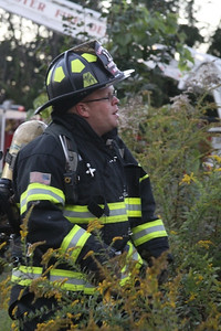 Firefighter Rick Marlow assists the ventilation crew.