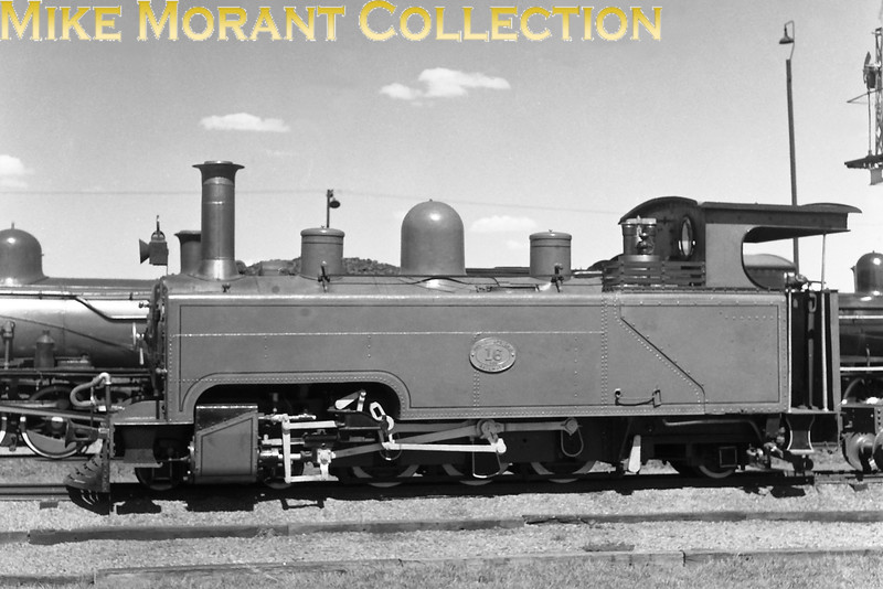 """South African steam railways - Cape Northern sytem.<br> Seen at De Aar in 1979, South African Railways class NG4 2' 0"""" gauge 4-6-2T locomotive NG.16 had been sold out of service in 1948, as the last surviving member of a group of seven locos built by Kerr Stuart & Co. for the Alfred County Railway (Port Shepstone - Harding, Natal). It had been built under KS works number 1344/1914. Sold for further use at Rustenburg Platinum Mines (North Western Transvaal), it had operated there as RPM No.8 - but had been stored out of service during the 1960s (following gauge conversion and the purchase of newer locos), then was donated to SAR in 1972 for preservation.<br> [A.E. """"Dusty"""" Durrant / <i>Mike Morant collection</i>]"""