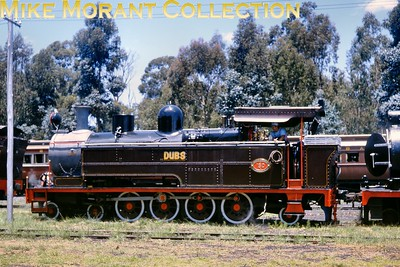 """South African industrial steam railways Dunns Locomotive and Boiler Works in Witbank, bought and sold (or hired out) many types of steam locomotives for industrial use in southern Africa. They also undertook major overhauls for customers and operated the Enyati Railway in northern Natal. Ex-South African Railways """"A"""" class 4-8-2T No. 150 """"Dubs"""" had been working at Witbank Power Station and outshopped in the latest ESCOM livery when seen at the works in 1980. [A.E. """"Dusty"""" Durrant / Mike Morant collection]"""