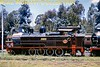 """South African industrial steam railways<br> Dunns Locomotive and Boiler Works in Witbank, bought and sold (or hired out) many types of steam locomotives for industrial use in southern Africa. They also undertook major overhauls for customers and operated the Enyati Railway in northern Natal. Ex-South African Railways """"A"""" class 4-8-2T No. 150 """"Dubs"""" had been working at Witbank Power Station and outshopped in the latest ESCOM livery when seen at the works in 1980.<br> [A.E. """"Dusty"""" Durrant / <i>Mike Morant collection</i>]"""