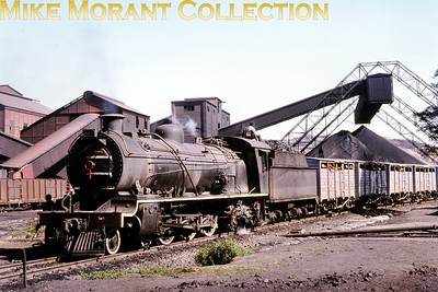 """South African industrial steam railways Heading a miners' shuttle train, ex-South African Railways 16CR class 4-6-2 No. 818 stands in the loading area of the Durnacol mine (Durban Navigation Collieries) near Dannhauser (Natal) in 1976. Durnacol No. 3 had been built by the North British Locomotive Company [under Atlas (Glasgow) works number 21714/1918] and reboilered by SAR in March 1954. [A.E. """"Dusty"""" Durrant / Mike Morant collection]"""