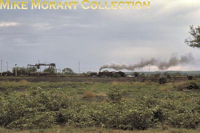 Rhodeais Railways An unidentified RR Beyer Garratt shunts in fading light at Livingstone (Zambia) in December 1972. [Jim Tinneny/Mike Morant collection]