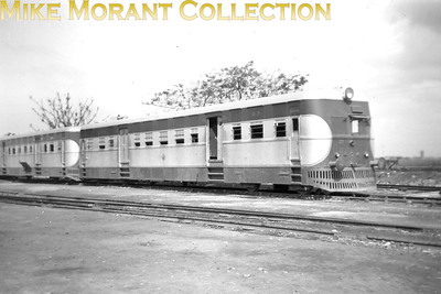 An Indian pre-partition shot of what is described as Bengal & Assam Railway diesel railcar no. 93 but the number on the front of the unit is 227 and I've been unable to find any reference to this type of unit on the web or in my books collection.  'Indian Locomotives: Part 1 - Broad Gauge 1851-1940' by Hugh Hughes, Continental Railway Circle 1990. Page 81 outlines a loco roster for the broad gauge North Western Railway and right at the end this lists 11 diesel-mechanical railcars. They were numbered 90 to 100 (which concurs with the number mentioned in the caption). They were built by Ganz in 1938 and rated at 210 hp. However, DMUs appear to have been rare in India and none of the other railways list anything similar [Mike Morant collection]