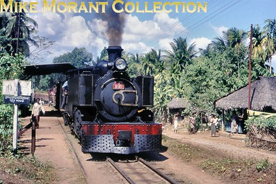 "Ceylon Government Railways Hunslet 2' 6"" narrow gauge J1 class 4-6-4T no. 221 in charge of the 09.35 Colombo Maradana  - Kottawa service at Kottawa station on 16/2/76. No. 221 was one of six members of the J1 class and was built in 1924 by Hunslet with works no. 1478 but I have no data regarding withdrawal other than that the narrow gauge lines were converted to broad gauge from 1991 onwards and the entire system since 1982 is known as Sri Lankan Railways. As at 7/2/17 no. 221 is stored unserviceable at Colombo Dematagoda shed  [Mike Morant collection]"
