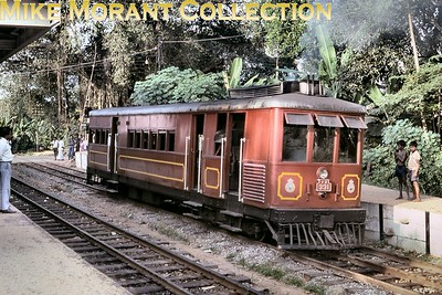 "Restored Ceylon Government Railways 2' 6"" narrow gauge Sentinel V2 class geared steam railcar no. 331, works no. 7303/1928, at Narahenpita on 10/1/92. This magnificent museum piece is now stranded as a static exhibit because there are no longer any narrow gauge tracks left for it to run on. [Martin Robinson / Mike Morant collection]"