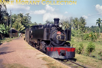 """Ceylon Government Railways Hunslet 2' 6"""" narrow gauge J1 class 4-6-4T no. 221 in charge of the 09.35 Colombo Maradana  - Kottawa service during its stop at Udahamulla station on 16/2/76. No. 221 was one of six members of the J1 class and was built in 1924 by Hunslet with works no. 1478 but I have no data regarding withdrawal other than that the narrow gauge lines were converted to broad gauge from 1991 onwards and the entire system since 1982 is known as Sri Lankan Railways. As at 7/2/17 no. 221 is stored unserviceable at Colombo Dematagoda shed  [Mike Morant collection]"""