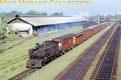 """Ceylon Government Railways Hunslet 2' 6"""" narrow gauge J1 class 4-6-4T no. 292 taken in 1975 at the transfer sliding between Colombo Maradana  and Colombo fort . No. 292 was the last built of six members of the J1 clas in 1929 with works no. 1636 but I have no data regarding withdrawal other than that the narrow gauge lines were converted to broad gauge from 1991 onwards and the entire system since 1982 is known as Sri Lankan Railways. As at 7/2/17 no. 292 is stored unserviceable at Colombo Dematagoda shed  [Mike Morant collection]"""