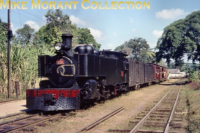 """Ceylon Government Railways Hunslet 2' 6"""" narrow gauge J1 class 4-6-4T no. 221 in charge of the 09.35 Colombo Maradana  - Kottawa service at Narahenpita station on 16/2/76. No. 221 was one of six members of the J1 class and was built in 1924 by Hunslet with works no. 1478 but I have no data regarding withdrawal other than that the narrow gauge lines were converted to broad gauge from 1991 onwards and the entire system since 1982 is known as Sri Lankan Railways. As at 7/2/17 no. 221 is stored unserviceable at Colombo Dematagoda shed  [Mike Morant collection]"""