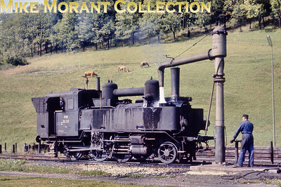 Austrian steam locomotive ÖBB 2-6-0 tank engine no. 91.32 slakes its thirst in the delightfully rural surroundings at Mürzzuschlag on 9/9/68.