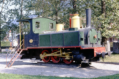 The only thing that's Austrian about this image is that it was photographed in a children's playground in Feldkirch in July 1971. This 0-6-0T no. 5 Bercher originated with the metre gauge LEB (CF Lausanne-Echallens-Bercher)and was built by SACM in 1890 with works no. 4172. It was sold for construction work on the Grande Dixence dam in Valais and later moved to Austria ending up there in this stuffed and mounted state. All was not lost because, in 1973, it was moved to the Blonay-Chamby line.