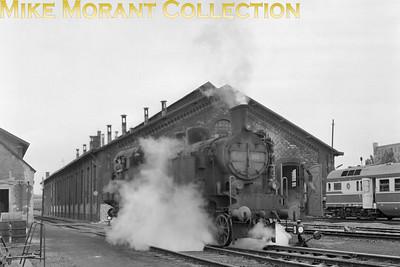 Austrian steam locomotive ÖBB 4-6-2 tank engine no. 77.253 with steam leaking everywhere at Wien Ost depot.