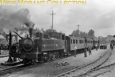 French narrow gauge railway  -  Réseau Breton RCTS visit on 6-7-57 Compagnie Fives - Lille 1909 built 4-6-0T no. E328 with the RCTS charter train at Callac. This pretty railway sytem and its equally attractive rolling stock became largely defunct in 1967 and fortunately two of these Fives locos have survived into the heritage era. [Mike Morant collection]