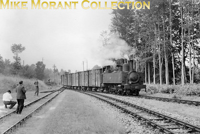 French narrow gauge railway  -  Réseau Breton RCTS visit on 6-7-57 The tour participants take time out at Merdrignac to photograph a passing freight train hauled by Compagnie Fives - Lille 1909 built 4-6-0T no. E330. This pretty railway sytem and its equally attractive rolling stock became largely defunct in 1967 and fortunately two of these Fives locos have survived into the heritage era.