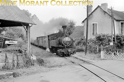 "PO Corrèze Mallet 0-4-4-0T no. 104 on freight duty in 1951. The location has been described by a Ferrovissime forum member as:  ""Ici il s'agit du passage à niveau du Pont de la Pierre sur la RN 140 à Laguenne (Tulle)."" No. 104 was built by Blanc-Misseron / Tubize in 1906 with works number 1476. We are fortunate that this engine is still with us at the Chemin de fer du Vivarais. [Mke Morant collection]"