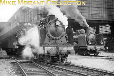 """AL (Chemins de fer d'Alsace et de Lorraine) 4-6-0 no. 1102, depicted here departing from Gare de Metz in 1938, was a Henschel product that would soon become 230.G.102 under SNCF ownership. In the background can be seen the slightly older AL 4-6-0 no.  960 which would become SNCF no. 230.D.960. A viewer has informed me that both trains are heading northwards. More detailed historical background for these engines comes from Jean-Daniel Muller: """"AL S10 1102, built by Henschel, works n°11 195, 1913; AL S9 960, built by Grafenstaden, n°5940, 1907"""""""