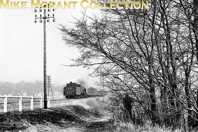 SNCF 2-8-0 no. 140 C 27 working tender first whist in charge of a freight train on its way to the limestone plant at Dugny in 1970. Note the second photographer's ghostly appearance amongst the trees! [Mke Morant collection]