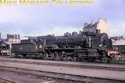 SNCF two cylinder simple 2-8-2 no. 141 C 170, a design dating from the period 1921 thru' 1923, from the Ouest Region of France. This class was copied from a P.O. (Paris Orléans) prototype. 250 were built for the Etat as 141 B with only 1,660 hp indicated power but were subsequently reclassified as 141 C after slightly raising the boiler pressure. 250 were built. They were used often for regional passenger trains on hilly lines. The last one has been withdrawn 1970. There's no supplied date for this slide but a viewer informs me that the location is probably dépôt Le Havre. N.B. This slide was sold to me as an original via Ebay but I now have reason to believe that it's actually a very good copy. It's so good, in fact, that it had me fooled which takes some doing. However, it's still  possible that it is the original unless the owner of that comes forward.