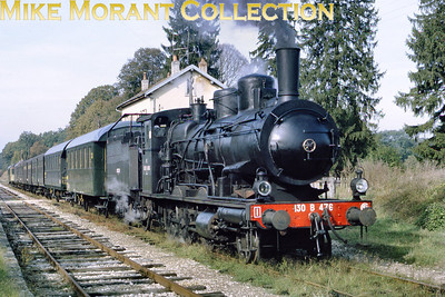 """SNCF 2-6-0 no. 130 B 476, from the Est Region of France photographed at Oyrières was on the Chalindrey-Gray line on either 10th or 17th October 1970 whilst in charge of a special train for a British railfans group. Some rolling stock data comes from Jean-Daniel Muller: """"The two first steel bodied four-wheelers are of German origin. -- First one, with tapered roof over platforms: ultralight design DRG Ci-33for secondary lines (tare 14,5t), 5 1/2 open compartments (2+3 seating) + 1 toilet at one end (6 windows), built between  December 1933 and December 1934. -- Second one: one of the famous and numerous """"Donnerbüchsen"""" (nicknamed """"Far-West"""" in France because of open platforms) DRG Ci-28, 29 or 30, six open compartments, toilet in middle (7 windows) All the others (except the last with an open door), behind, are 6 wheelers rebuilt with steel bodies and pneumatic folding central doors from old PLM carriages. The second last one with open door is necessarily a four-wheeler DRG Bi-29 with closed vestibules). The last one cannot be easily identified."""" [Mke Morant collection]"""