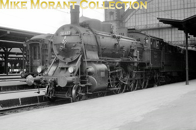 Pre-war German steam  -  Deutsche Reichsbahn-Gesellschaft (DRG) Maffei built Bavarian BR S 3/5 H 4-cylinder compound 4-6-0 no. 38 457 awaits departure from München Hbf circa 1938. Note the swastika applied to the smokebox door which, I've been told, is most unusual and I suspect that it has more to do with the crew's affiliations rather than with officialdom.
