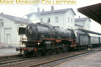 German steam locomotive Deutsche Bundesbahn oil fired pacific no. 01 230 is depicted in charge of a Dortmund local service at Soest in June 1967.