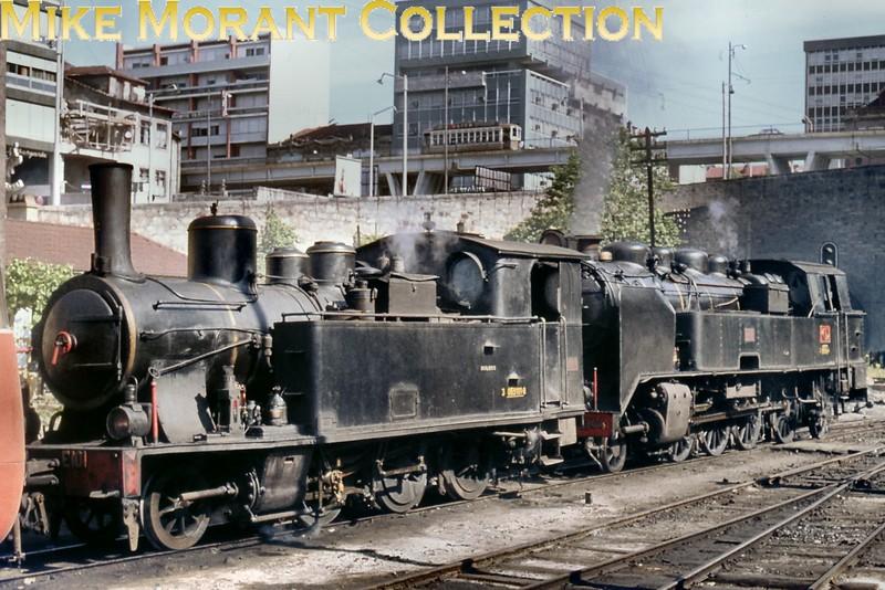 Portugal metre gauge steam engine<br> Subject: 2-6-0T no. E101 & 2-8-2T no. E144<br> Builder: Kessler 3420/1907 & Henschel ?????/1931<br> Location: Porto Trinidade<br> Date: 10/6/74<br> Status: E101 and E144 Lousado museum<br> [<i>Mike Morant collection</i>]