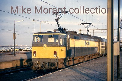 NS  - Nedelandsche Spoorwegen - Dutch Railways Co-Co electric locomotive no. 1503 in charge of boat train at Hoek van Holland station in April 1971. 1503 was originally British Railways EM2 class no. E27004 and one of seven  - the entire class -  purchased by NS in 1969 but was withdrawn in October 1986. [M. B. Lewis / Mike Morant collection]