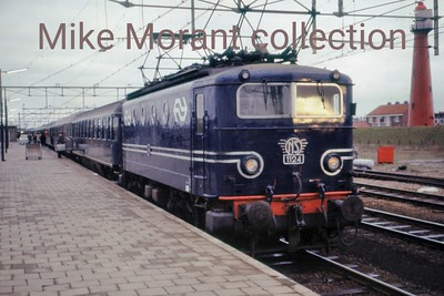 NS   - Nederlandsche Spoorwegen -   1100 class Bo-Bo electric locomotive no. 1124 in blue livery prepares for departure from Hoek van Holland on an unspecified date in 1972. [Mike Morant collection]