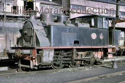 Dutch industrial railways locomotive. Oranje Nassau Mijnen (Heerlen) 0-6-0T no. 14 was a producet of La Meuse 3052/1924 that was withdrawn from service in September 1969 and is depicted here a year or so later in October 1970.  No. 14 was saved from the cutter's torch and is currently, November 2015, in the custodianship of the Stichting tot Behoud van Mijnlocomotieven in her spiritual home of Limburg. [Mike Morant collection]