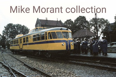 On 17-9-83 Uithoorn, my home town at the time, was blessed with a rare railway visitor in the form of NS 20 affectionately known as De Kameel (The Camel) and it was purely by chance that I happened to catch sight of it from a lijndienst 170 bus which, at the time, still used Petrus Steenkampweg and Wilhelminakade as its route. By the time that I arrived at the station with my camera we were in the midst of the heaviest rain of the entire year but the event just cried out to be photographed and this is the third of the series that I shot. One had to feel sorry for the majorettes who were both drenched and cold but carried on as do all the best troupers. [Original colour negative by Mike Morant]