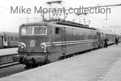 NS  - Nedelandsche Spoorwegen - Dutch Railways Co-Co electric locomotive no. 1305 in charge of a boat train at Hoek van Holland on 26/8/67. [Mike Morant collection]