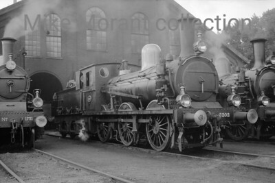 Pre-war Dutch steam locomotives  -  Vooroorlogse Nederlandse stoom locomotieven Depicted outside Arnhem's former SS-shed (demolished in 1961) is 0-6-0 no. 3202 which was built by Sharp Stewart (Glasgow) and entered service in 1905 as HSM no. 602. Paul Henken informs me that both 1731 at the left and 3202 were Arnhem allocated engines for the period  27th March until 22nd June 1936 which neatly narrowes the timescale during which this picture was taken. No. 3202 bears some similarity to the NBR Holmes 'C' class (or LNER J36) which isn't perhaps alll that surprising as 15 of that class were built at the same works. 3202 was withdrawn from service in 1938. [Original negative: Mike Morant collection]