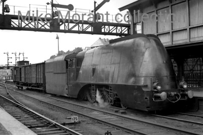 Pre-war Dutch steam locomotive  -  Vooroorlogse Nederlandse stoom locomotief This is Arnhem looking westwards circa August 1936 and the strange looking locomotive is no. 3804 which was the prototype for the small series of Dutch attempts at streamlining. In reality it was a 3700 class 'Jumbo' 4-6-0  - built by Henschel to a Beyer Peacock design in 1920 -  with some modifications behind the cladding. The remaining four locos that were similarly but not identically rebuilt were nos. 3800/1/2/3 which entered service in 1937 and 3805 in 1938. The cladding was eventually removed from this engine on 16-7-43 at the workshops in Zwolle. No. 3804 was an Utrecht allocated engine from February until December 1936 and would have been a frequent visitor to Arnhem and this view probably shows a shunting movement between the train 513 Amsterdam Weesperpoort – Arnhem (10.38 – 11.54 uur)  and train 524 Arnhem – Amsterdam Weesperpoort (13.07 – 14.25 uur). Behind the somewhat ungainly streamlined engine there is a bogie baggage car type 'D' (series 6000, formerly HSM). 3804 has one last claim to fame as it was officially the last steam locomotive withdrawn from service by NS in February 1958. [Original negative: Mike Morant collection]