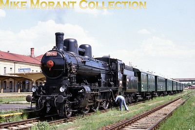 With distinctive double-dome and connecting steam pipe, two-cylinder 2-6-2 No. 354.7152 with 4-8-4T No. 464.102 at České Velenice in May 2000. The ex-Austrian (kkStB type 429) locomotives inherited by the ČSD had been built in a number of versions between 1909 and 1917 - with the compounds being converted to simples over a period of time. Its Austrian-type double smokebox doors had been replaced with a circular type. [Basil Roberts / Mike Morant collection]