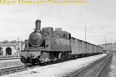 Le Réseau Breton narrow gauge railway Piguet-Lyon built Mallet 0-6-6-0T no. E413 in charge of a substantial freight train passes dépôt Carhaix.