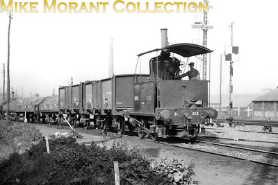 Cdf du Nord 0-4-0VBT (Vertical Boiler Tank) no. 2.012 was the shed pilot dépôt Boulogne and is shown here going about its duties on 20/9/1928. This class comprised 35 examples and 2.012 was one of a batch of twelve  built in the period 1881-1883  by Société Franco-Belge but only two survived into SNCF ownership in 1938 and this example wasn't one of those. There's an interesting difference in the linguistic interpretaion for vertical boilered engines: the French nickname is bouteilles d'encre (ink bottles) whilst the British describe them as coffee pots. [Mike Morant collection]