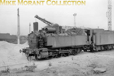 LOCATION ???? An unidentified SNCF Nord region 0-8-0T from the two-cylinder simple, non superheated 040 TA class shown here adjacent to an ex Prussian tender as used by Nord Atlantics and Pacifics in the 1920s after they had been improved for speed. The 040 TA class was originally built by the Nord in the years 1871-1880 as powerful 0-8-0 tender engines for heavy goods trains and was numbered in the 180 series. Then, in the period 1907 thru' 1914, they were rebuilt as tank engines and numbered Nord 4.1801 to 4.1908. [Mike Morant collection]