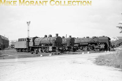 SNCF 2-8-0's nos. 140 C 121 and 113 plus a 141R at dépôt de Belfort. [Mike Morant collection]