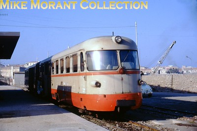 Strade Ferrate Sarde  Sardinian -  95cm gauge railcar. These ADm50 class 2-car units have 2 x Fiat 150 HP diesel engines with mechanical transmission. Several are apparently still around today but this quite attractive livery was superseded many years ago. [Mike Morant collection]