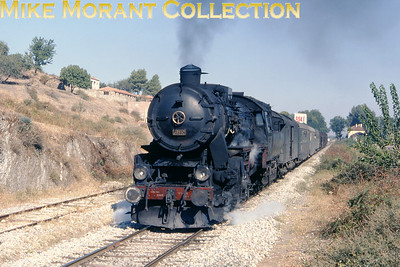 Turkish State Railways [Türkiye Cumhuriyeti Devlet Demiryollari] German built Kriegslok (Baureihe 52) 2-10-0 no. 56550 in charge of an Izmir - Afyon mixed train at Tordali on 27/9/77.