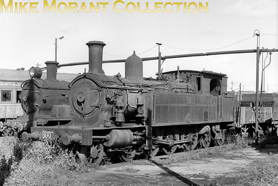 AUSTRALIAN STEAMNew South Wales Government Railways  NSWGR class 30 4-6-4T locomotive No. 3003 on shed - c.1971. One of the early batch of Thow's S-type suburban tanks delivered by Beyer Peacock & Co. in 1903. Behind it is a 53-class 2-8-0 possibly 5443.. [A. E. 'Dusty' Durrant / Mike Morant collection]