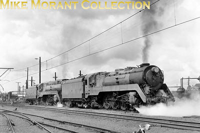 AUSTRALIAN STEAMNew South Wales Government Railways  The two variants of NSWGR 38-class Pacific locomotives - fully-streamlined No. 3801 and standard No. 3813 - have been serviced and are ready to leave the dépôt beneath the wires in the Sydney suburbs - c.1971.. [A. E. 'Dusty' Durrant / Mike Morant collection]