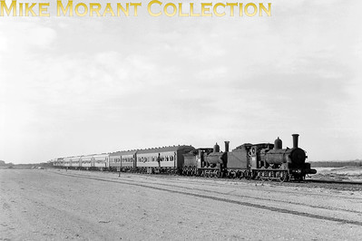 AUSTRALIAN STEAMNew South Wales Government Railways  A pair of veteran NSWGR class 19 inside-cylinder 0-6-0 locomotives, Nos. 1904 and 1923 -usually based at Port Waratah for dépôt shunting duties, were rostered to head a special working c.1971.. [A. E. 'Dusty' Durrant / Mike Morant collection]