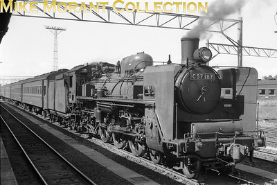 JNR (Japanese National Railways) steam locomotive C57 187 was a 4-6-2 and was one of 215 examples of this design of pacific built between 1937 and 1953 according to Wikipedia. This shot was taken in 1973 but with no indication of the location.