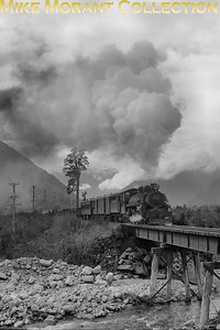 New Zealand Government Railways A class 2-cylinder pacific no. 472 was built in New Zealand by A & G Price with works no. 36 entering NZGR service on 13/3/1911 and is depicted here passing through the Otira Gorge South Island's west coast.on 27/8/60. Withdrawal for 472 came in September 1966. [Derek Cross / Mike Morant collection]