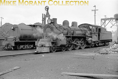 NZR (New Zealand Railways) class A 4-6-2 no. 426 at Invercargill on 12th November 1964. The protruding tender in the background belongs to an Ab class pacific. Photographed by John Brouwer [Mike Morant collection]