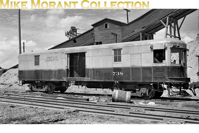 American Aggregates 'critter' No. 738 at Oxford MI on July 17th, 1948. This image attracted barely a glance for 2 years on my former web site and suddenly it became heavily viewed (June 2010) courtesy of a posting on the Ry-ops-industrialSIG Yahoo e-group. The text, courtesy of Dennis Storzek, Big Rock, IL, is as follows; American Aggregates, now there is a company that used to have some interesting motive power at their various pits around Ohio, Indiana, and Michigan. Back in the thirties, when the midwest interurban system was in its death throes, AA bought a bunch of interurban box motors; the things that look like self propelled baggage cars. They'd slip a skid mounted diesel generator set into the carbody, wire it to the existing electrical gear, and have an instant locomotive. The engineer (motorman?) just throttled up the gen-set, then ran the thing with the trolley controller. After having problems with some of the early conversions sagging under the weight of the large engine and generator, later conversions were shortened by cutting a chunk out of the middle and splicing the body back together. Each loco was unique; most had some sort of louvers installed in at least one of the former baggage doors for airflow through the radiator. They kept their interurban pilots and radial couplers. The last ones likely died in the early sixties; some have been acquired by museums for their parts. Thank you, Dennis, for the clarification. For what it's worth, I bought this image as 'an original negative' on ebay but I'm pretty sure it's a copy from a print. [Mike Morant collection]