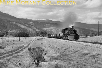 D&RGW narrow-gauge steam locomotive No. 483 exiting Monero Canyon CO with a train from Chama NM to Durango CO, over the line since abandoned. [Photographer: R. E. Field/Mike Morant collection]