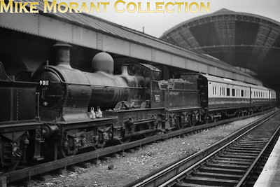 RCTS: Swindon & Highworth Railtour 25/4/54 Collett 'Dukedog' 4-4-0 no.  9011 and Maunsell blood & custard stock on the SE side of Victoria station. [Mike Morant collection]