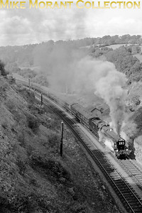 "LCGB: Farewell to the G.W.R. 'County Class' 20/9/64 Hawksworth County class 4-6-0 no. 1011 storms spectacularly up Sapperton bank whilst in charge of its penultimate railtour. [Photograph: A. E. ""Dusty"" Durrant / Mike Morant collection]"